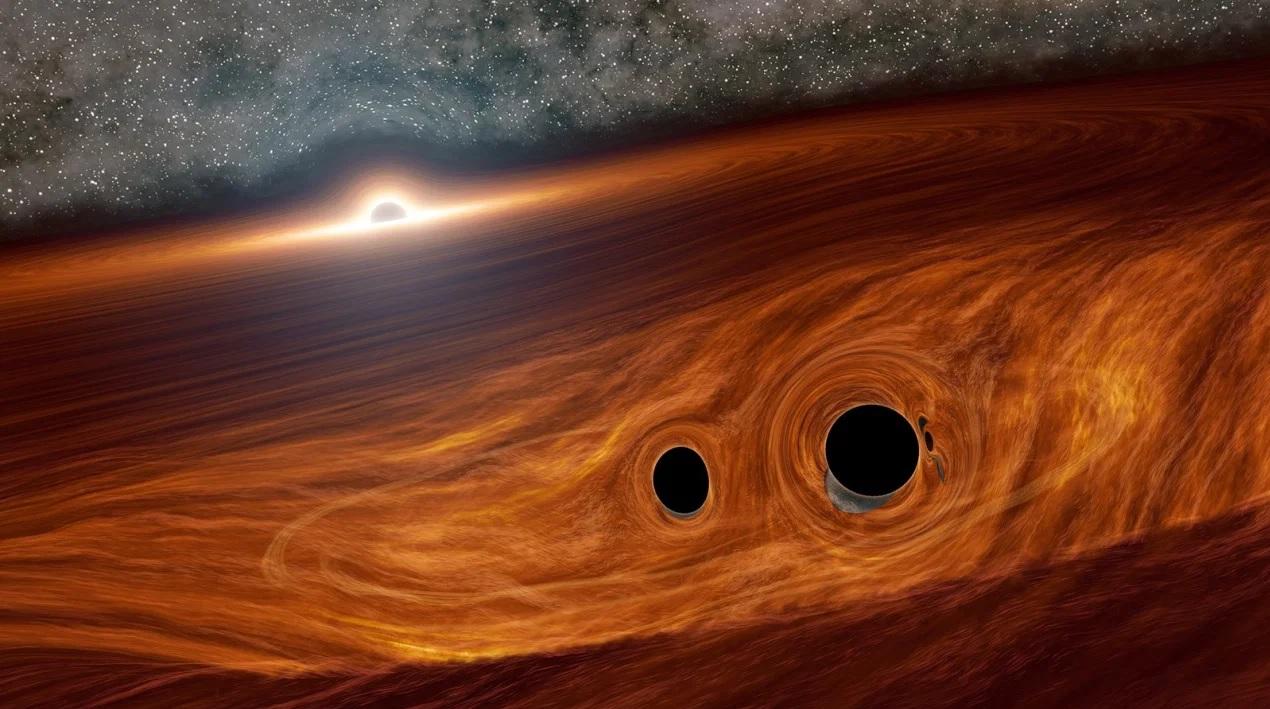 фото двух черных дыр отмечают