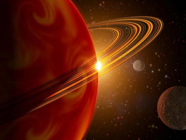 NASA показало фотографию двух кратеров на спутнике Сатурна, смотрящих на...