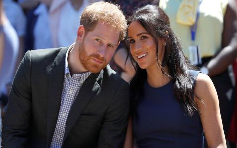 принц Гарри и Меган Маркл сидят рядом
