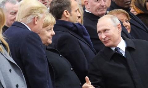 Путин и Трамп коротко побеседовали в Париже