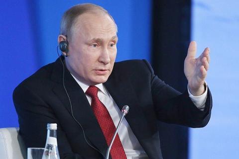 """Владимир Путин пошутил над переводчиком и назвал его """"бандитом"""""""
