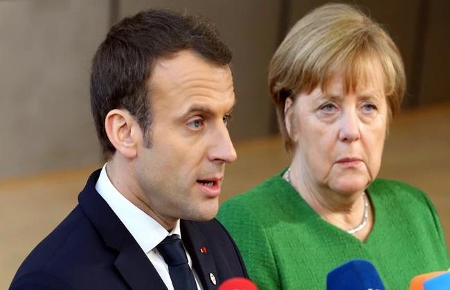 Меркель и Макрон высказались за быстрое решение вопроса о членстве России в СЕ