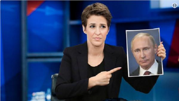Взбешенная Рейчел Мэддоу всю передачу тыкала пальцем в портрет Путина